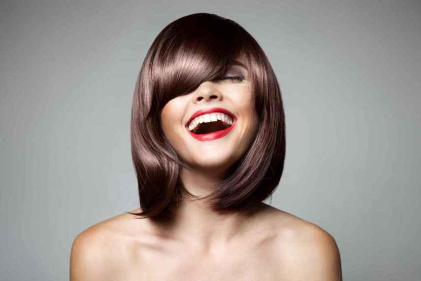 Smiling Beautiful Woman With Brown Short Hair. Haircut. Hairstyl - RoyalRetreat Beauty and SPA- Dubai